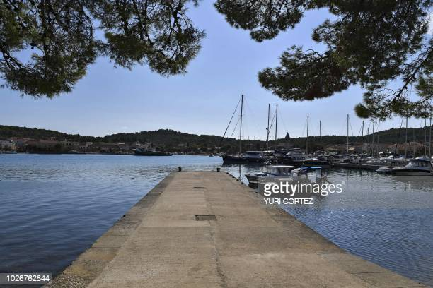 Yachts remain anchored at one of the island of Kornati National Park on the Adriatic coast Croatia on September 4 2018 The Kornati Islands...