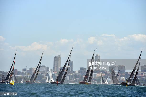 Yachts sail out of Sydney Harbour at the start of the Sydney to Hobart yacht race on December 26 2018 / IMAGE RESTRICTED TO EDITORIAL USE STRICTLY NO...