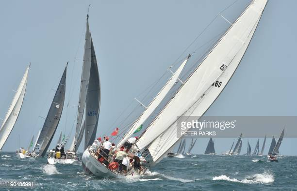TOPSHOT Yachts sail out of Sydney harbour at the start of the Sydney to Hobart yacht race on December 26 2019 / IMAGE RESTRICTED TO EDITORIAL USE...
