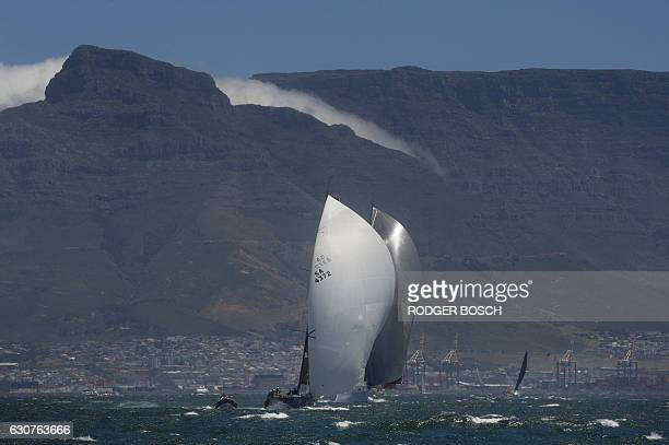 Yachts sail out of Table Bay, with Table Mountain in the background, at the start of the Cape to Rio yacht race off the coast of Cape Town on January...