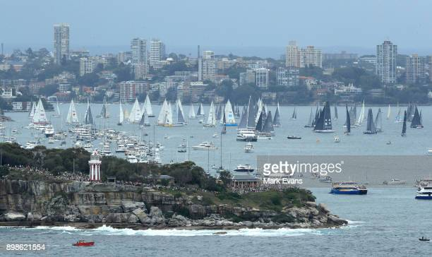 Yachts sail up Sydney Harbour after the start of the Sydney to Hobart Yacht race during the 2017 Sydney to Hobart on December 26 2017 in Sydney...
