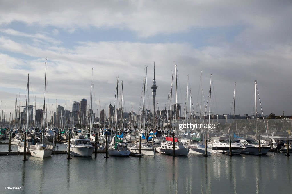 Yachts sit moored at a marina as the Sky Tower, background center, stands among other buildings in the central business district in Auckland, New Zealand, on Tuesday, Aug. 13, 2013. New Zealand's growth rate is forecast to outpace Australia's for the next two years, helping stem an exodus that's resulted in the highest proportion of its people living overseas in the developed world after Ireland. Photographer: Brendon O'Hagan/Bloomberg via Getty Images