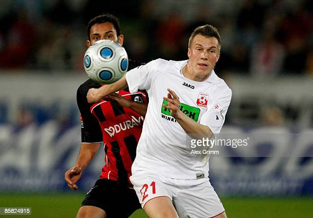 Yacine Abdessadki of Freiburg challenges Kevin Grosskreutz of Ahlen during the Second Bundesliga match between SC Freiburg and Rot Weiss Ahlen at the...