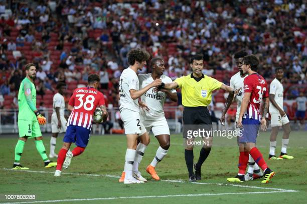 Yacine Adli of Paris Saint Germain and Roberto Olabe of Atletico Madrid are separated by the referee during the International Champions Cup match...