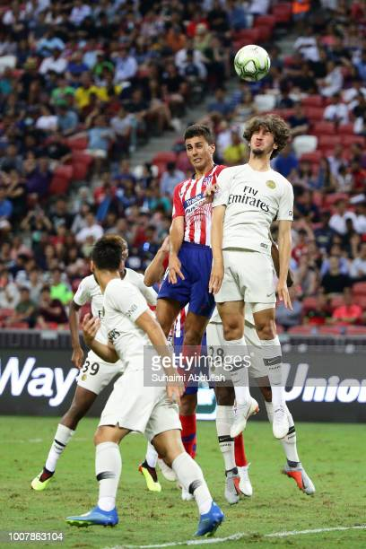 Yacine Adli of Paris Saint Germain and Rodri of Atletico Madrid jump for the ball during the International Champions Cup 2018 match between Atletico...