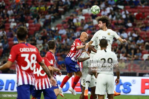 Yacine Adli of Paris Saint Germain and V'ctor Mollejo of Atletico Madrid jump for the ball during the International Champions Cup 2018 match between...
