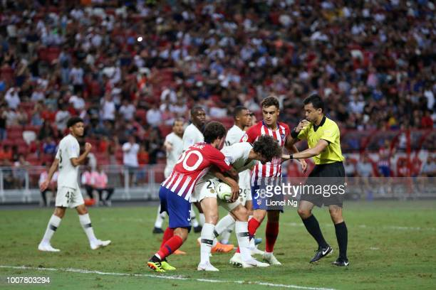 Yacine Adli of Paris Saint Germain holds onto the ball as Roberto Olabe of Atletico Madrid tries to get the ball back during the International...
