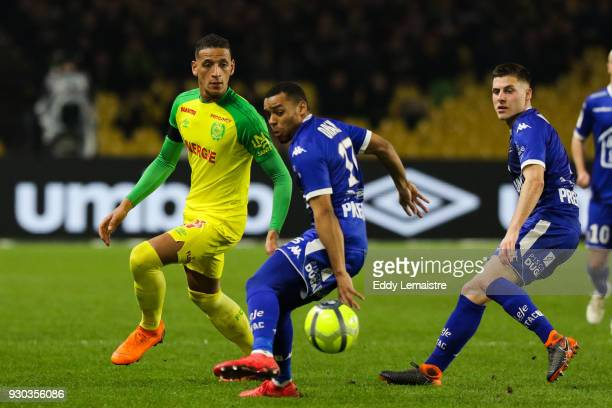 Yacine Bammou of Nantes and Johann Obiang of Troyes during the Ligue 1 match between Nantes and Troyes AC at Stade de la Beaujoire on March 10 2018...