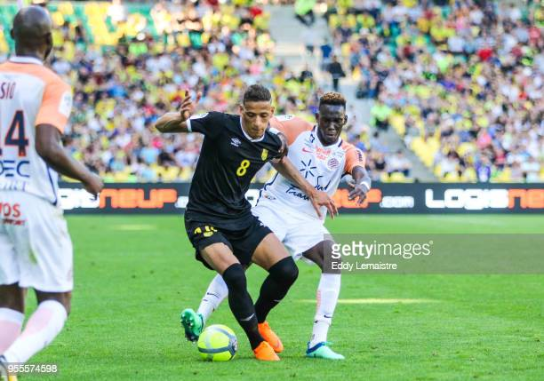 Yacine Bammou of Nantes and Junior Sambia of Montpellier during the Ligue 1 match between Nantes and Montpellier Herault SC at Stade de la Beaujoire...