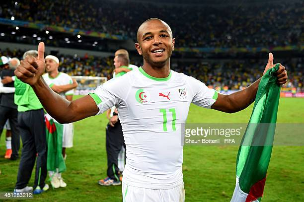 Yacine Brahimi of Algeria celebrates qualifying for the knock out stage after the 11 draw in the 2014 FIFA World Cup Brazil Group H match between...