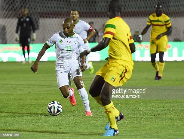 Yacine Brahimi of Algeria moves the ball against Mali during their Coupe D`Afrique Des Nations qualifying match September 10 2014 in Blida Algérie...