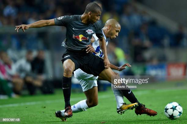 Yacine Brahimi of FC Porto competes for the ball with Bernardo Junior of RB Leipzig during the UEFA Champions League group G match between FC Porto...