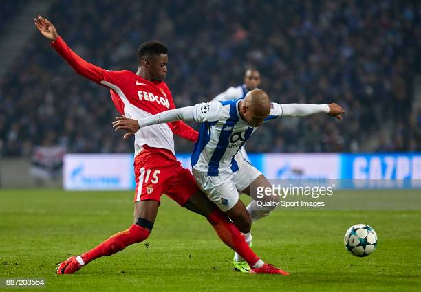 Yacine Brahimi of FC Porto is challenged by Adama Diakhaby of AS Monaco during the UEFA Champions League group G match between FC Porto and AS Monaco...