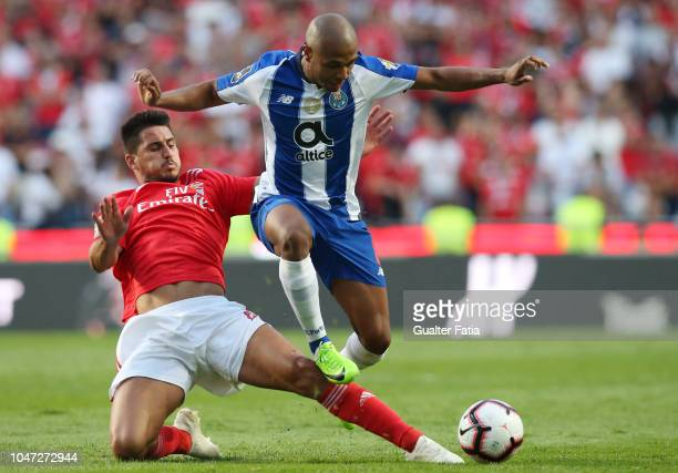 Yacine Brahimi of FC Porto with Gabriel Appelt of SL Benfica in action during the Liga NOS match between SL Benfica and FC Porto at Estadio da Luz on...