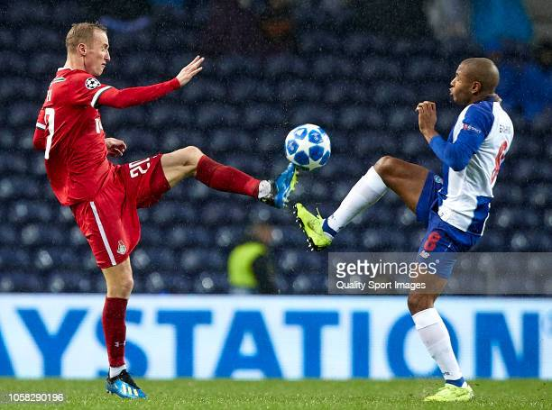 Yacine Brahimi of Porto competes for the ball with Vladislav Ignatyev of Lokomotiv during the Group D match of the UEFA Champions League between FC...