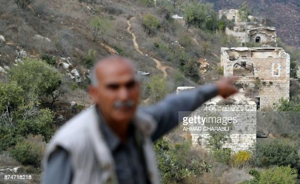Yacoub Odeh a 77yearold Palestinian points at old houses in the Palestinian village of Lifta which was abandoned during fighting in the 1948...