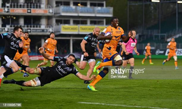 Yacouba Camara of Montpellier makes a break and runs through to score their first try during the European Rugby Challenge Cup match between Bath...