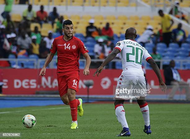 Yacouba Coulibaly of Burkina Faso vies with Mohamed Amine Ben Amor during the 2017 Africa Cup of Nations quarterfinal football match between Burkina...