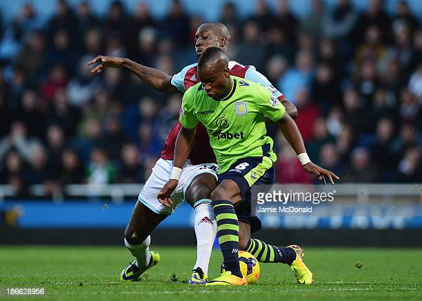 Yacouba Sylla of Aston Villa is challenged by Carlton Cole of West Ham United during the Barclays Premier League match between West Ham United and...