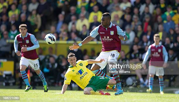 Yacouba Sylla of Aston Villa is challenged by Wes Hoolahan of Norwich City during the Barclays Premier League match between Norwich City and Aston...