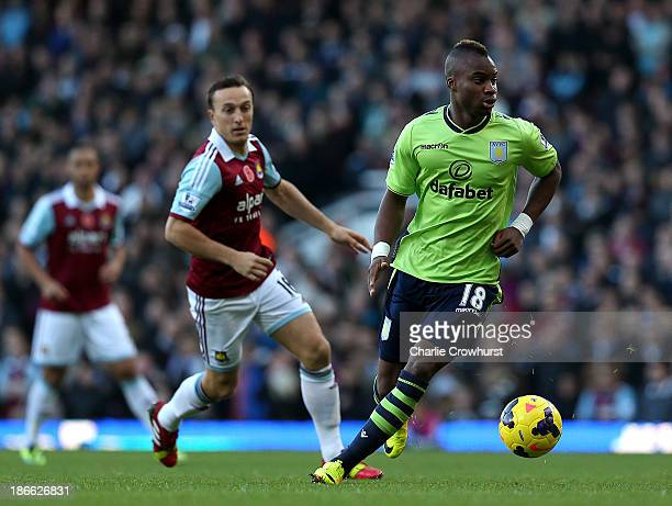 Yacouba Sylla of Villa runs with the ball during the Barclays Premier League match between West Ham United and Aston Villa at Upton Park on November...