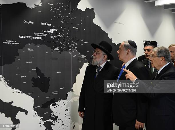 Yad Vashem Chairman Avner Shalev flanked by Israeli Prime Minister Benjamin Netanyahu and Rabbi Yisrael Meir Lau point at a map showing where Jews...