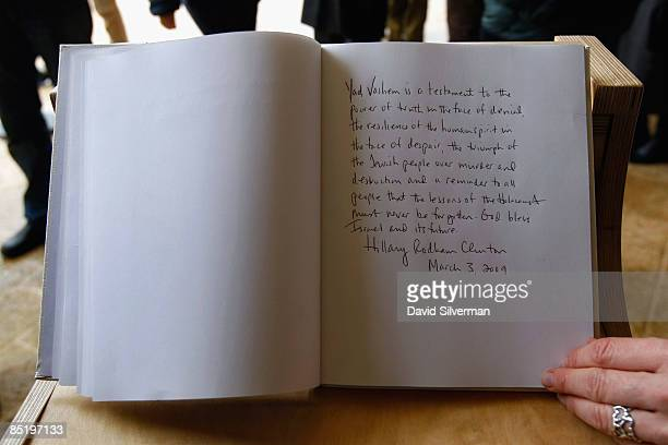 Yad Vashem official displays the page in the guest book signed by US Secretary of State Hillary Clinton during her visit to the Holocaust memorial...