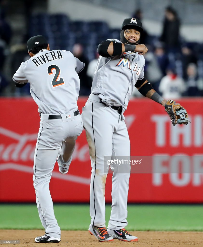 Yadiel Rivera #2 and Starlin Castro #13 of the Miami Marlins celebrate the 9-1 win over the New York Yankees at Yankee Stadium on April 17, 2018 in the Bronx borough of New York City.