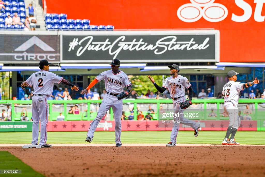 Yadiel Rivera #2 , Lewis Brinson #9 Cameron Maybin #1 and Starlin Castro #13 of the Miami Marlins celebrate after the game against the Chicago Cubs at Marlins Park on April 1, 2018 in Miami, Florida.