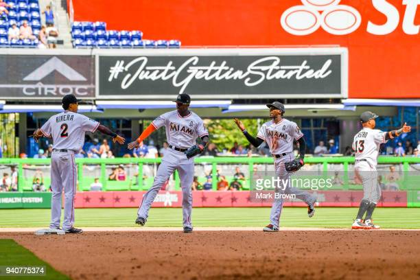 Yadiel Rivera Lewis Brinson Cameron Maybin and Starlin Castro of the Miami Marlins celebrate after the game against the Chicago Cubs at Marlins Park...
