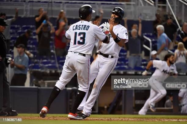 Yadiel Rivera of the Miami Marlins celebrates with Starlin Castro after scoring the game winning run in the ninth inning to defeat the San Diego...