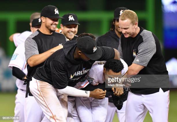 Yadiel Rivera of the Miami Marlins is mobbed by teammates after hitting a walk-off single in the 10th inning against the Philadelphia Phillies at...