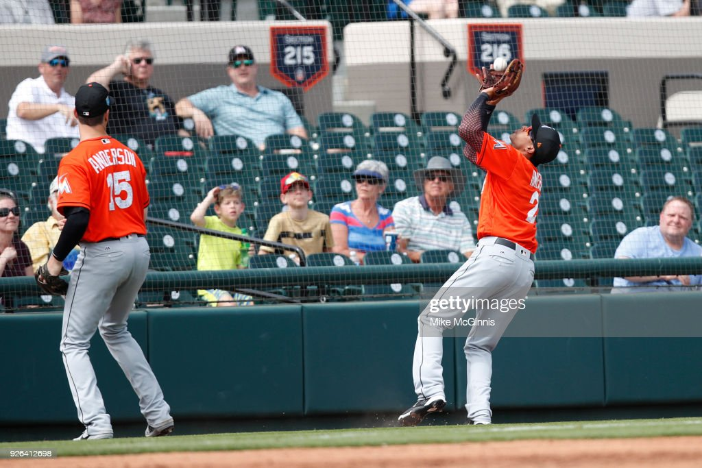 Yadiel Rivera #2 of the Miami Marlins makes the catch in foul territory to retire John Hicks of the Detroit Tigers during the second inning of the Spring Training game at Joker Marchant Stadium on March 02, 2018 in Lakeland, Florida.