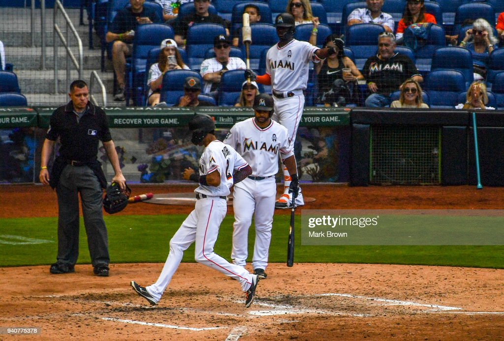 Yadiel Rivera #2 of the Miami Marlins scores in the fifth inning against the at Marlins Park on April 1, 2018 in Miami, Florida.