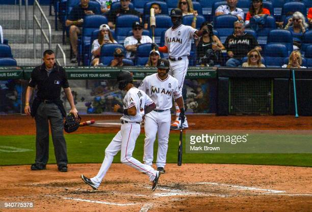 Yadiel Rivera of the Miami Marlins scores in the fifth inning against the at Marlins Park on April 1 2018 in Miami Florida