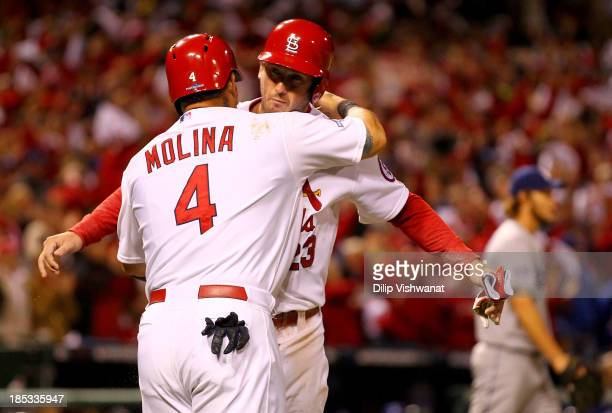 Yadier Molina and David Freese of the St Louis Cardinals celebrate after both scoring in the third inning against the Los Angeles Dodgers in Game Six...
