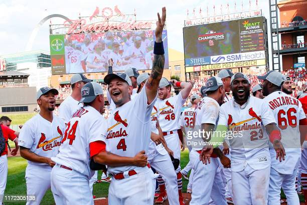 Yadier Molina and Jose Martinez of the St. Louis Cardinals celebrate winning the National League Central Division after beating the Chicago Cubs at...