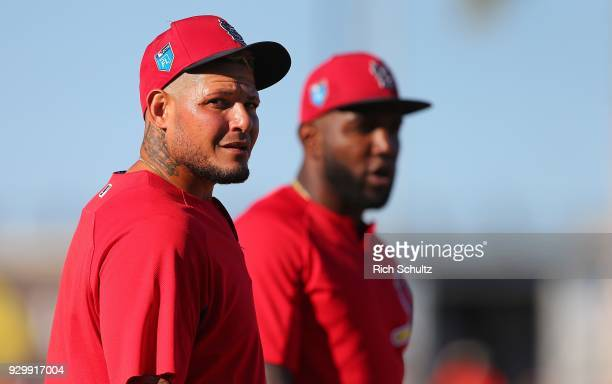 Yadier Molina and Marcell Ozuna of the St Louis Cardinals look on during batting practice before a spring training game against the Houston Astros at...