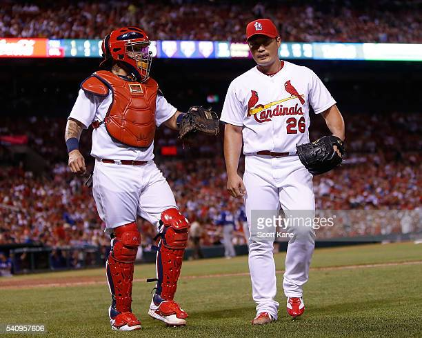 Yadier Molina congratulates Seung Hwan Oh of the St Louis Cardinals after Oh pitched during the eighth inning against the Texas Rangers at Busch...