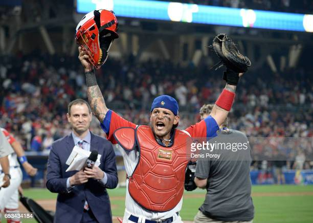 Yadier Molina of Puerto Rico celebrates after Puerto Rico beat the Dominican Republic 31 in the World Baseball Classic Pool F Game One at PETCO Park...