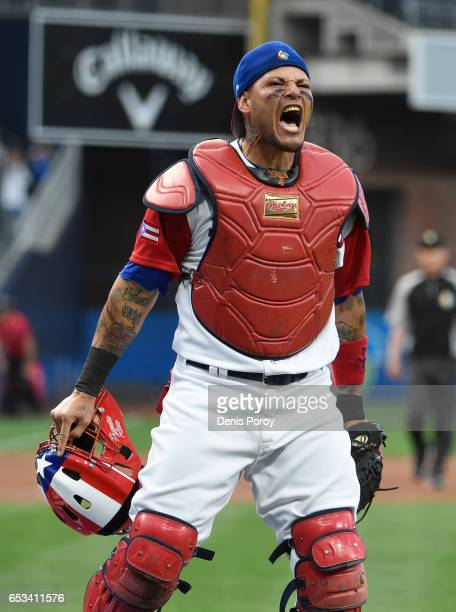 Yadier Molina of Puerto Rico reacts after tagging Jean Segura of the Dominican Republic out at the plate during the first inning of World Baseball...