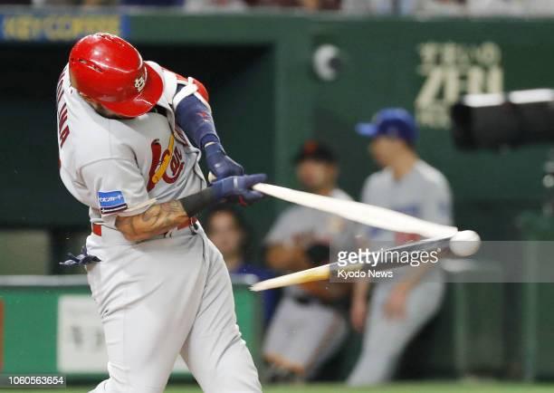 Yadier Molina of the Major League Baseball AllStars hits a brokenbat single in the fourth inning of Game 3 of the MLB allstar series against Samurai...