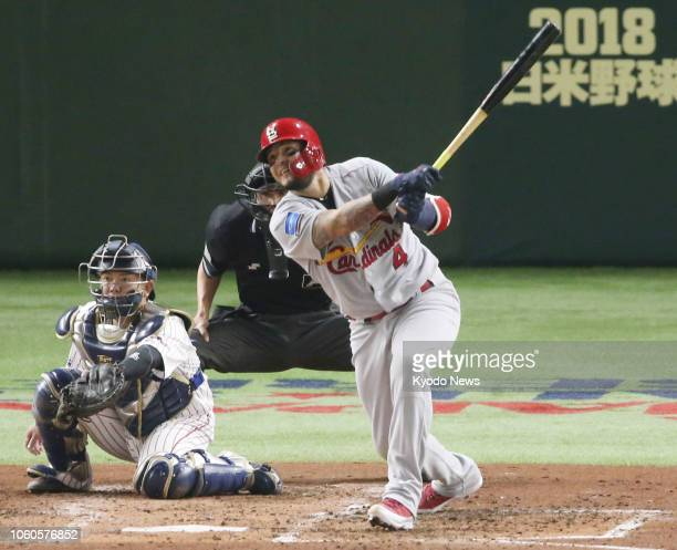 Yadier Molina of the Major League Baseball AllStars hits a threerun homer in the fifth inning of Game 3 of the MLB allstar series against Samurai...