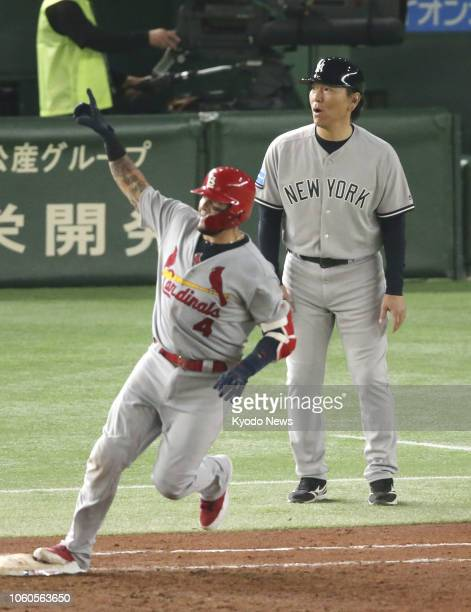 Yadier Molina of the Major League Baseball AllStars rounds the bases after hitting a threerun homer in the fifth inning of Game 3 of the MLB allstar...