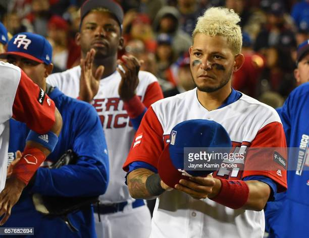 Yadier Molina of the Puerto Rico applauds the United States team after they won the 2017 World Baseball Classic March 22 2017 in Los Angeles...