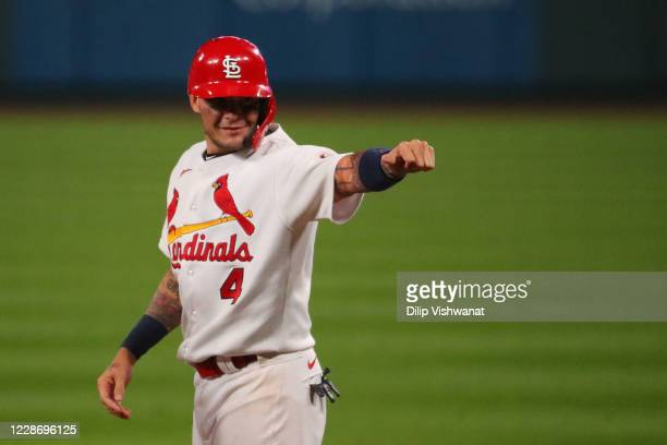 Yadier Molina of the St. Louis Cardinals acknowledges his teammates in the dugout after recording his 2,000th career hit with a single against the...