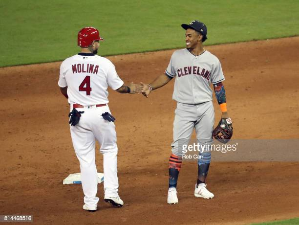 Yadier Molina of the St Louis Cardinals and the National League reacts with Francisco Lindor of the Cleveland Indians and the American League during...