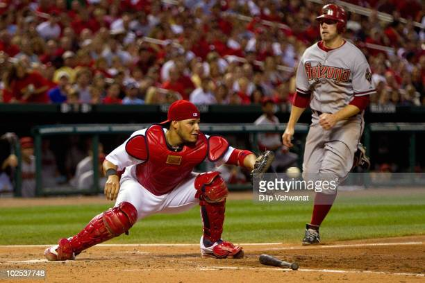 Yadier Molina of the St Louis Cardinals beats Mark Reynolds of the Arizona Diamondbacks to the plate at Busch Stadium on June 29 2010 in St Louis...