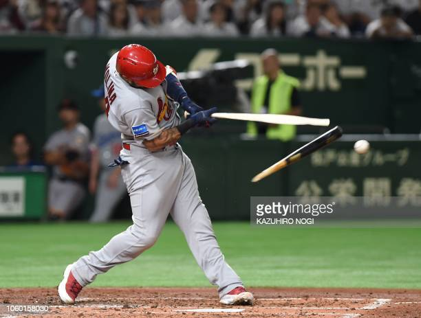 TOPSHOT Yadier Molina of the St Louis Cardinals breaks his bat as he singles during the fourth inning of the third exhibition baseball game between...