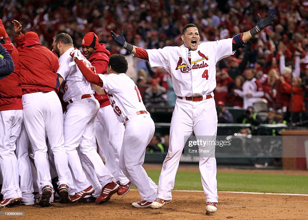 Yadier Molina #4 of the St. Louis Cardinals celebrates after David Freese #23 hits a walk off solo home run in the 11th inning to win Game Six of the MLB World Series against the Texas Rangers at Busch Stadium on October 27, 2011 in St Louis, Missouri. The Cardinals won 10-9.
